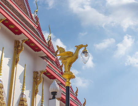 Golden swan lamp in temple at thailand photo