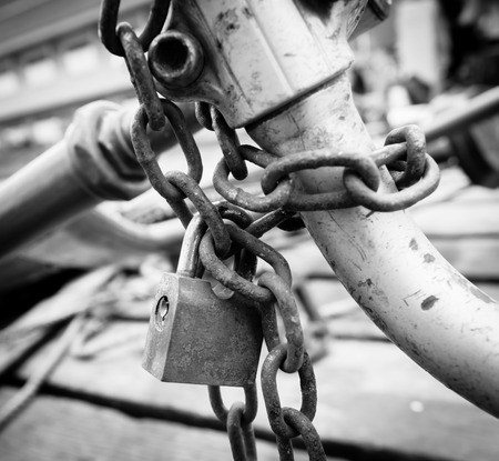 old rusted lock and chain, close up  photo