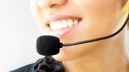 contact center: woman  call-center assistant smiling , isolated