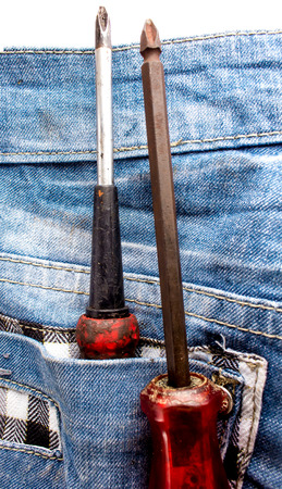 Two screwdrivers in jeans pocket photo
