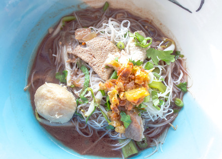 thicken: thai pork noodle thicken soup in bowl