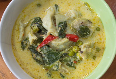 Green curry fish balls in bowl photo