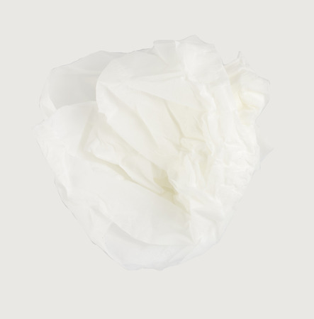 crumpled tissue paper on gray background. photo