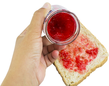 hand jam: bread with strawberry jam in hand