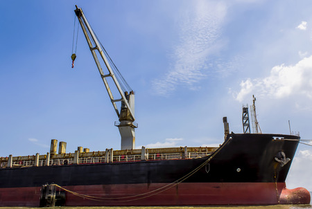 merchant: Merchant Marine ,blue Sky and White Cloud,with hoisting cranes on ship Stock Photo