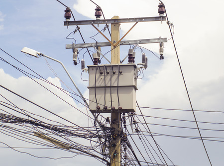 tangling: Electricity transformer and power lines on electric pole Stock Photo