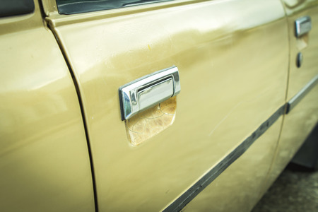 Old Car Door Handle.Close up image retro style photo