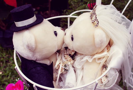 love image: Two  teddy bears kissing each other - concept for love ,image vintage style