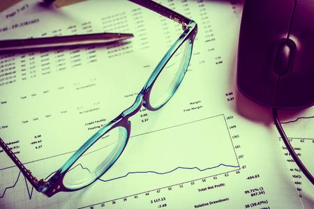 Analysis of financial reports.Retro style photo