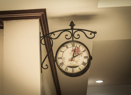 The clock on the wall in the home , vintage style photo