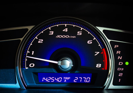mileage: Dashboard of a car with a high mileage.