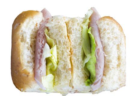 sanwich: sliced sanwich with ham, and salad