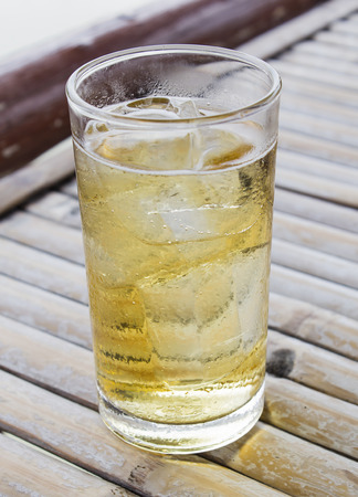 alcoholic beverage: alcoholic beverage and ice on table wooden