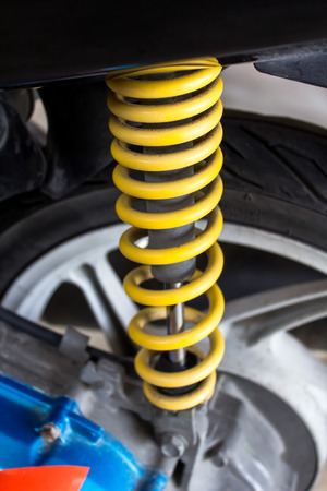 absorber: dirty yellow  shock absorber of motorcycle Stock Photo