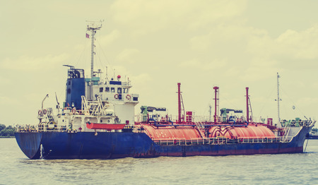 water transportation: Petrochemical gas energy in water transportation industry,vintage tone Stock Photo