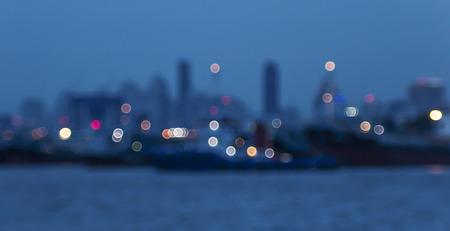 dark city: bokeh of boat in the river Stock Photo