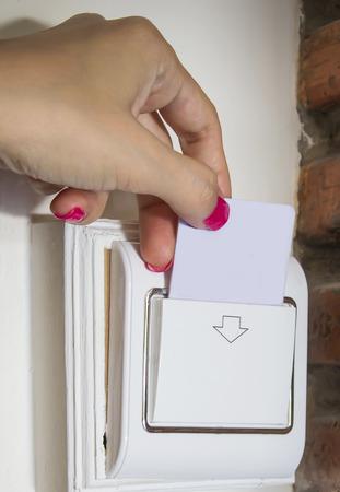 keycard: Female hand touch keycard on hotel door