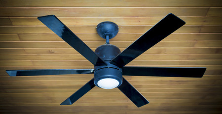 fan ceiling: ceiling fan on a wooden ceiling Stock Photo