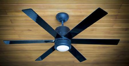 ceiling fan on a wooden ceiling