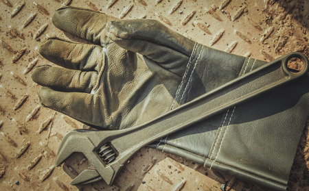 work gloves: Old work gloves and  wrench