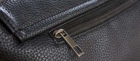 Close up of black leather bag zipper