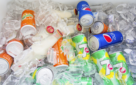 breezy: BANGKOK, THAILAND - March 5, 2016 : Can of Pepsi and Seven Up and Mirinda  and other brands of drinks lying on ice . Breezy drinks for summer