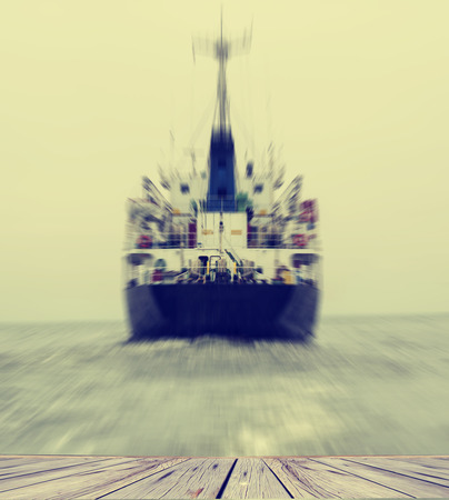 stern: Stern of the ship in close up with working screw and rudder view back ship in the sea,Image blur style and vintage tone