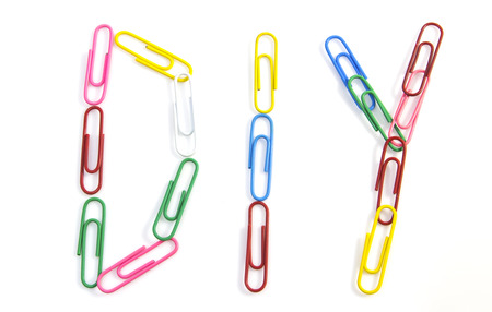 Colorful paper clips for office usage on white background Stock Photo