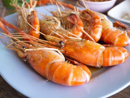 Shrimp burned on a blue plate ,Street food