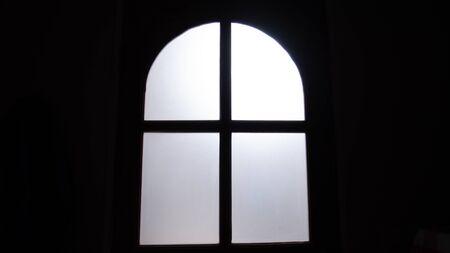 The light neon mirror the door in the dark bedroom