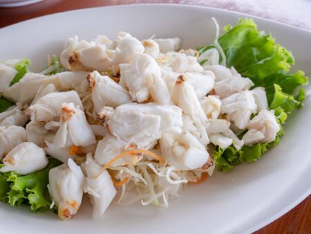 crab meat on the white dish , seafood