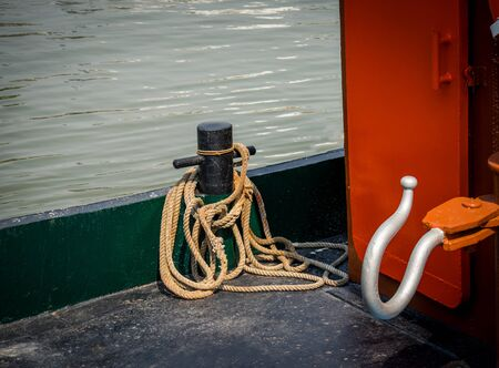 Mooring ropes and hooks on the boat Imagens