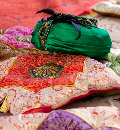 religious clothing: East  the lush green turban and decorative pillows