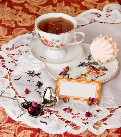 Rose Tea party with  marshmallows,brewing tea with rosebuds photo