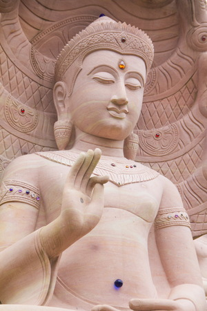 dhamma: White stone carving buddha with naga at Wat Tai Phra Chao Yai Ong Tue,Ubonratchathani Province,Thailand.