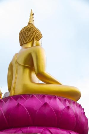 dhamma: Backside of Buddha with sky at Ubonratchathani,Thailand. Stock Photo