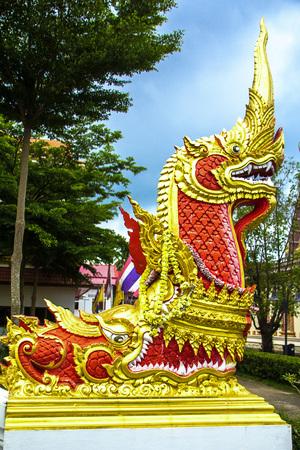 Red Naga sculpture on the stairs of Luang Phor Ngern statue  at Wat Paknam Boong Sapang Ubonratchathani. Stock Photo