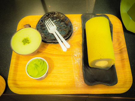 Set of green tea roll cake, green tea latte coffee and green tea ice cream in green tea shop at Osulloc tea museum, Jeju island, South Korea. Stock Photo