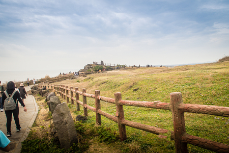Jeju Island, Korea - November 13, 2016 : The tourist visited beautiful landscape view of Seopjikoji, located at the end of the eastern shore of Jeju Island. Seopji is the old name for the area, and Koji is Jeju dialect meaning a sudden bump on land. Editorial