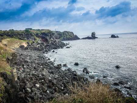 Beautiful landscape view of eopjikoji, located at the end of the eastern shore of Jeju Island. Seopji is the old name for the area, and Koji is Jeju dialect meaning a sudden bump on land. Stock Photo