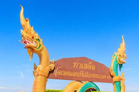 naga china: Beautiful Nagas on billboard. Words on the billboard Translated from Thai to English as  Tha Sadet Pier, the edge of Thailand border at Nong Khai City.