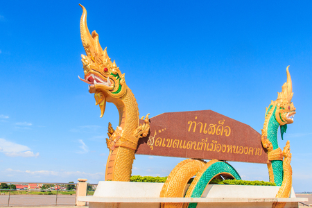 Beautiful Nagas on billboard. Words on the billboard Translated from Thai to English as  Tha Sadet Pier, the edge of Thailand border at Nong Khai City.