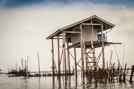 stilt: Hut in the sea that used for the owner to stay and guard his cockle farm in Samut Songkram, Thailand