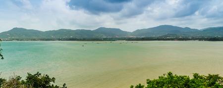 Beautiful panorama view of Chalong bay (Ao Chalong) in the cloudy day, view from Khao Khad (Kao-Khad) viewpoint, Tambol Wichit, Amphur Muang Phuket, Phuket Province, Thailand.