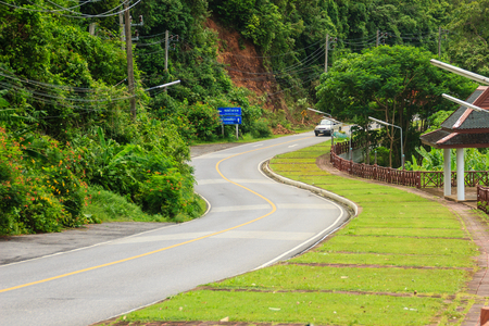 Beautiful Rural Road beside the beach arond Phuket islands, view from Khao-Khad viewpoint. From this viewpoint, tourists can enjoy the 180-degree view of Chalong bay. This Khao-Khad viewpoint is located in Tambol Wichit, Amphur Muang Phuket, Phuket Provin Stock Photo