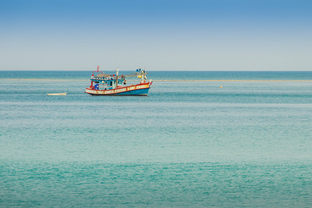 Fisherman boat and the Beautiful seascape view of Naiyang beach, the wonderful beach nearby Phuket international airport, Phuket Province, Thailand. Stock Photo