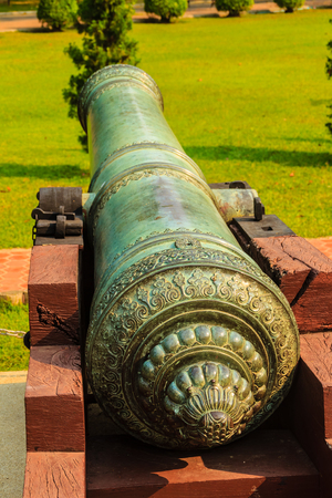 Beautiful of old cannon at Phra Ramratchaniwet Palace (Wang Ban Peun), former the king Rama 5 palace, one of the main public tourist attractions in Phetchaburi, Thailand