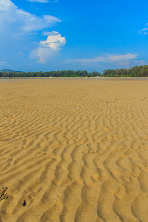 Exotic and beautiful wave pattern on the sand in the beach after sea water receded. Stock Photo
