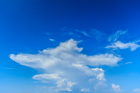 Clear blue sky with white clouds. Cloudless sky. Blue sky with a cloud obscured the view daytime desolate empty air clean. Stock Photo