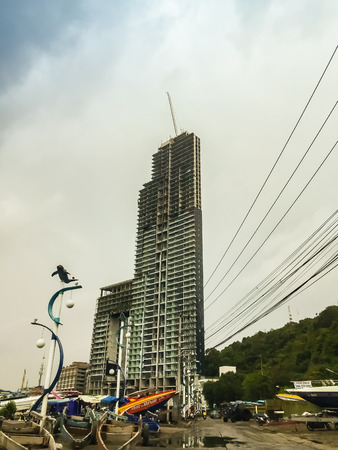 Pattaya, Thailand - January 21, 2016: The new highrise buildings obscured the beautiful of Pattaya bay view on Pratamnak Hill nearby Balihai pier in Pattaya,Thailand. Pattaya city is famous about sea sport and night life entertainment.